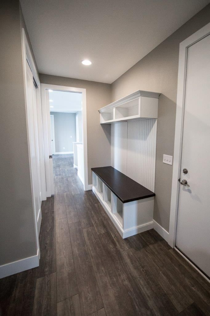#Custom mudroom with bench and shelving. #Mannington french oak #Peppercorn flooring