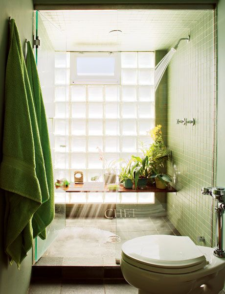 A touch of green brings a natural feel to this bathroom