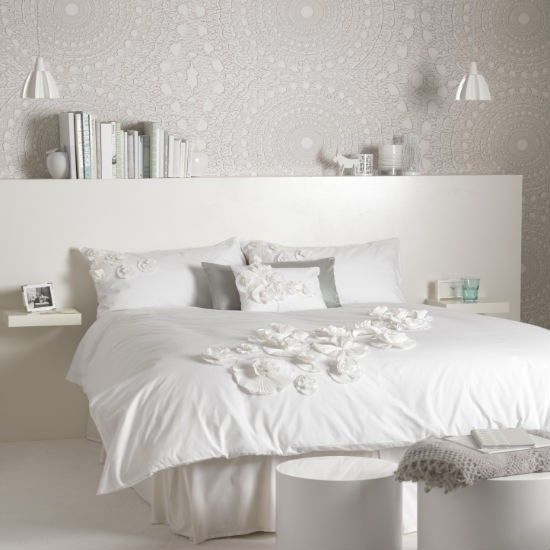 White and lace bedroom. Make an oversized lace-pattern wallpaper the starting point for the room. With a barely-there paper you can be bold with pattern.  Add a supersized headboard. Attach floating shelves as bedside tables and add low-hung pendants to minimise clutter.  All-white bed linen is a must for this look  just layer it up with pillowcases, cushions and throws with lace or crochet details. Different textures are the key to making the scheme three-dimensional rather than flat.