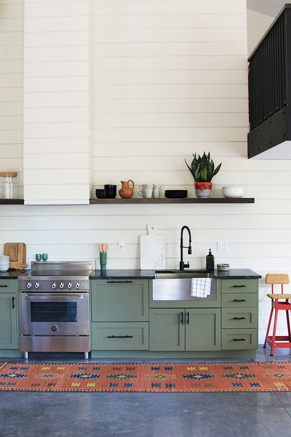 Benjamin Moore Tate Olive on the cabinets and French Canvas on the walls.