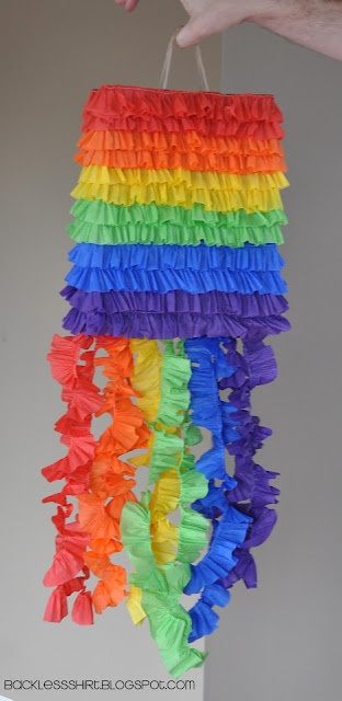 DIY Rainbow Party Pinata...made from a brown paper shopping bag!!  So cute and less expensive than purchasing one at the store!!