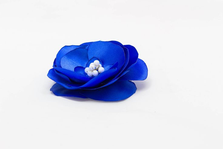 A personal favourite from my Etsy shop https://www.etsy.com/ie/listing/576473059/statement-blue-kanzashi-satin-ribbon