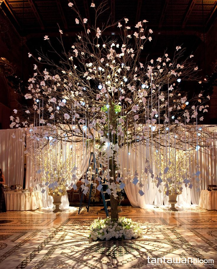 The 16 feet escort card tree with orchids and hanging ribbons