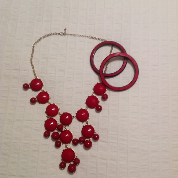 Bubble Necklace and bangles Red Bubble necklace and two wooden bangle bracelets. Like new condition. Necklace has adjustable chain to vary the length. Jewelry Necklaces