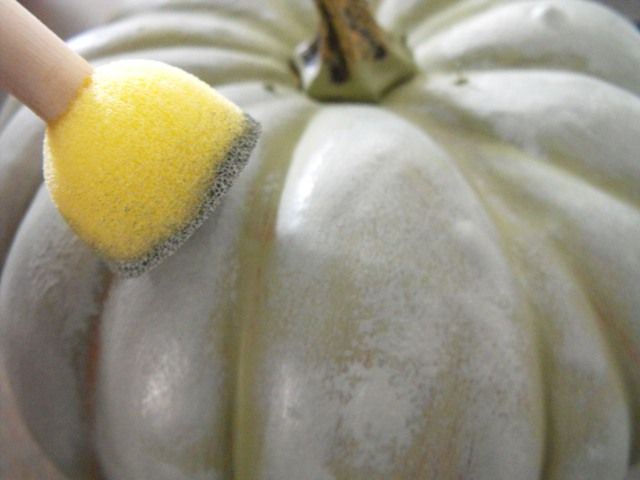 DIY Faux Painted Pumpkins - How to turn those cheap plastic orange (mark down) pumpkins into stylish expensive looking decor - Fab Tutorial with detailed steps including the paint colors she used to achieve the look.