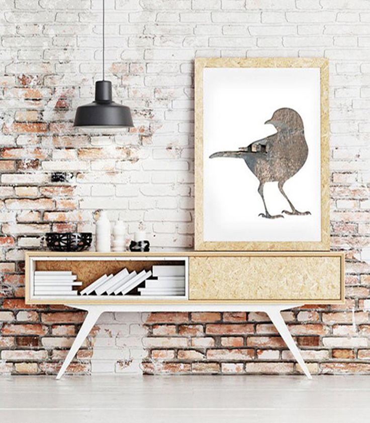 This sweet bird silhouette is by Etsy shop Bialakura. The fact that it's in shades of brown makes it look a bit softer. Also very cool: the fact that the frame and furniture are done in the same wood.