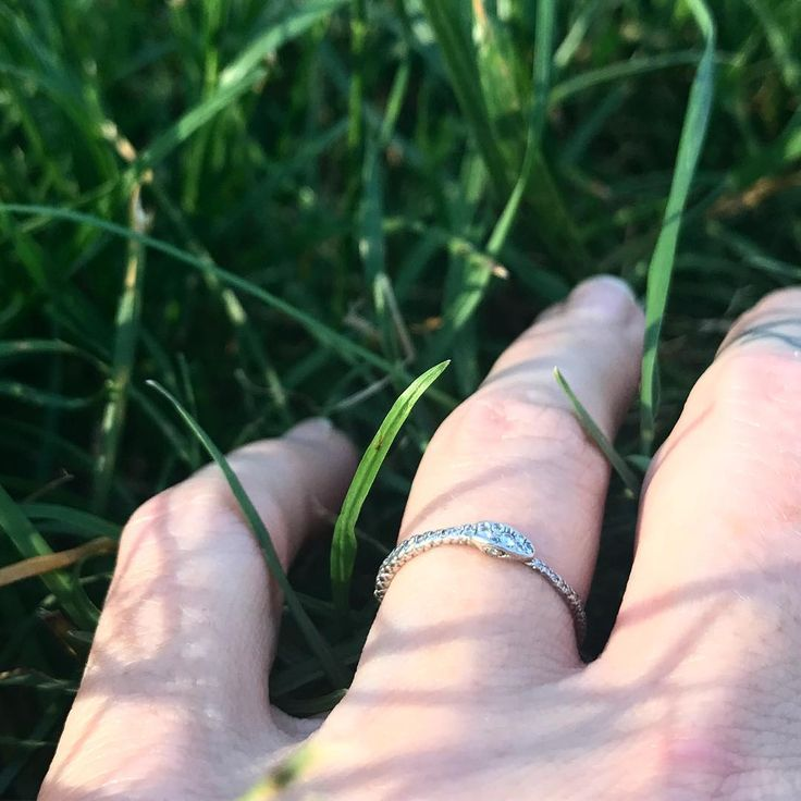 Snake in the grass 🐍Diamond pave & platinum Endless Love ring, perfection for the June bride. A potent symbol of eternity, protection and security ❤️ online at norakogan.com #junebride #modernbride #platinium #weddingring