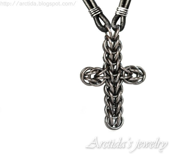 Male jewelry collection. Heavily oxidized (blackened) sterling silver chainmail cross on leather for men of all ages who love rugged yet clean design.  This is a masculine piece of jewelry for everyday apparel or a special occasion. Each hefty, 18 gauge sterling silver ring is hand coiled, hand cut, and polished smooth before weaving into a sterling silver cross. The cross is then heavily oxidized and again polished to a high shine. The pendant is threaded with double stranded black leather