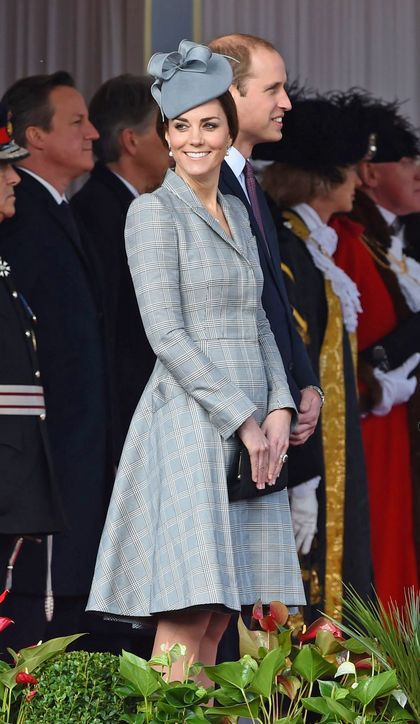 Kate Middleton in a gray plaid Alexander McQueen dress