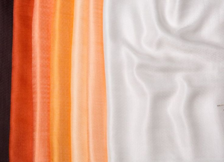 Shawls and scarves in orange and peach color scheme. Buy silk, chiffon, cashmere or wool shawls for both women and men exclusively from Le Patio. #scarves #shawls #warm #orange #white #peach #women #fashion #silk #cashmere