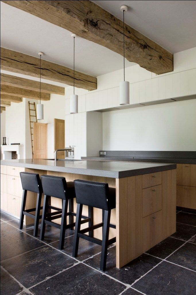 Stuyts - Realisaties - black white oak wood cabinets, black natural stone floor
