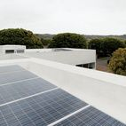 The roof features a cool roof, which reflects heat back to the sky rather than having it absorbed into the house, and 26 solar panels that often cause the meter to roll backward.  Photo by Jessica Haye and Clark Hsiao.