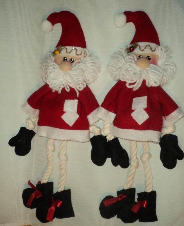 unas manualidades navideñas  para puertas con papá noel