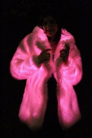 Glowing Pink Fur Coat - it really interests me how they the fabric glows. Is it just the type of fabric?? Does it need electricity?? Does it just need to be in the dark to work??