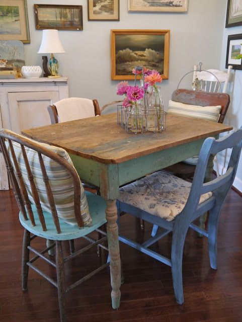 Love the rustic table with mismatched chairs. Could paint the bottom in cream gloss and sand the top