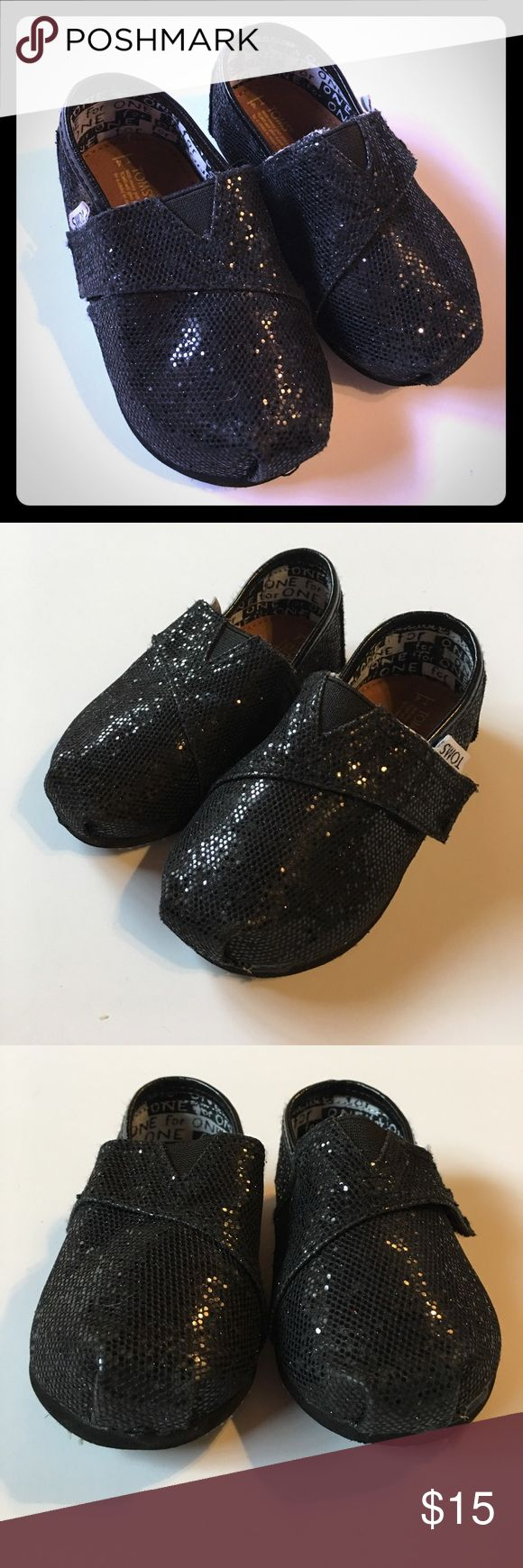 Black Glitter Tiny Toms - size T4 Black glitter Tiny Toms size 4. In great shape! TOMS Shoes