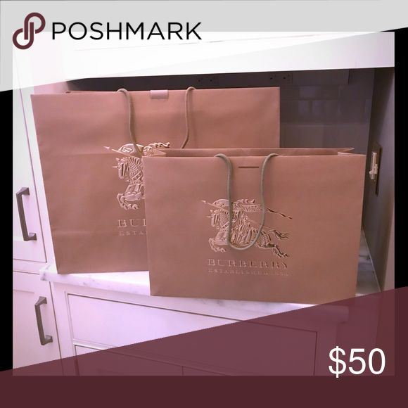 """Burberry Shopping Bags - Tan with Gold Logo Burberry Shopping Bags - Tan with Gold Logo 5 - 21"""" W x 16"""" T x 8"""" D 1 - 16"""" W x 12"""" T x 4"""" D Burberry Other"""