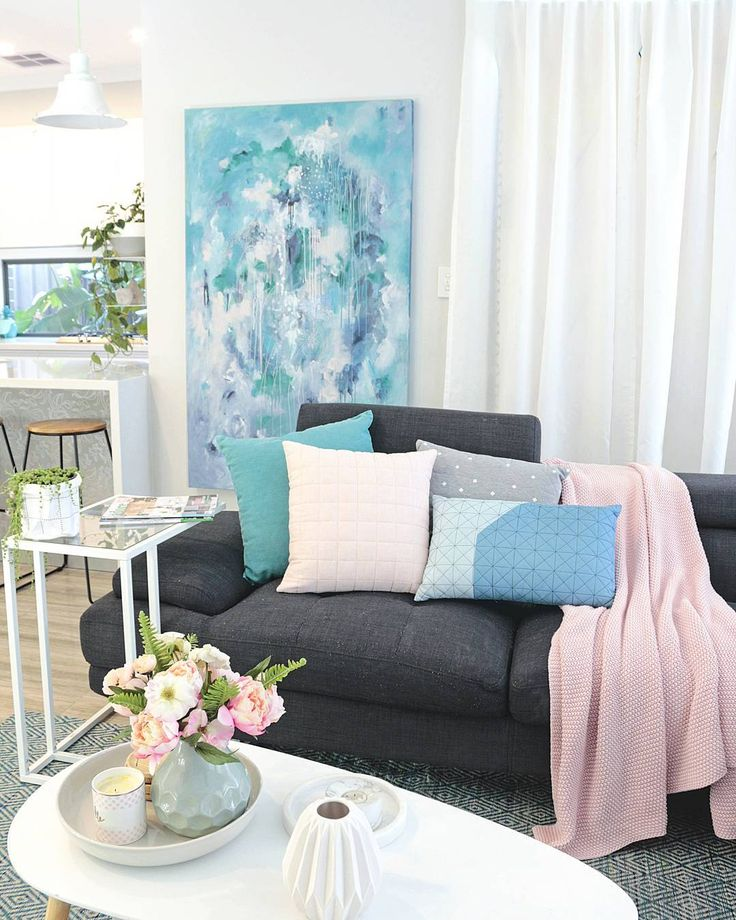 Contemporary modern scandinavian Australian living room in grey and white with pops of blue, and blush pink. Adairs cushions and throw. Kmart coffee table.  Original art painting by Australian artist Kate Fisher.