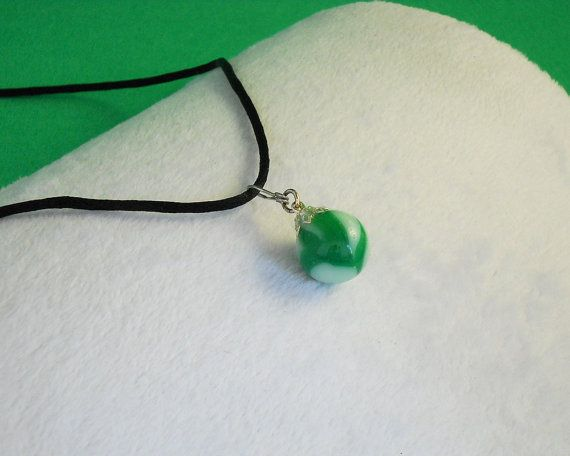 Green and white swirl marble necklace pendant.  The colors are one of my favorite features of this necklace. It has a unique mix of green and white swirls that collide with... #etsymntt #accessories #vintage #jewelery #jewellry #repurposed #silver