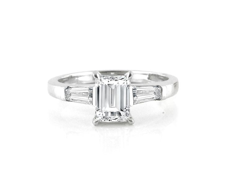 A Modern 18ct White Gold and Diamond Trilogy Ring