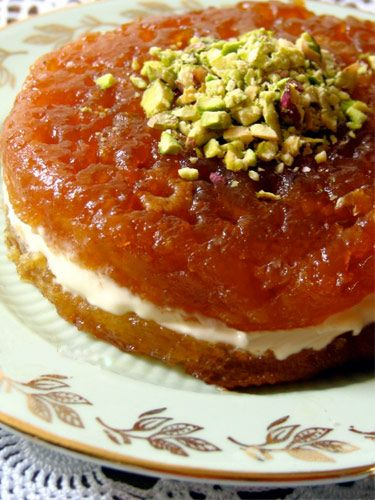 Ekmek kadayıfı/ decadent Turkish bread cake cooked in caramelized sugar syrup, served with kaymak (thick Turkish clotted cream), topped with pistachio