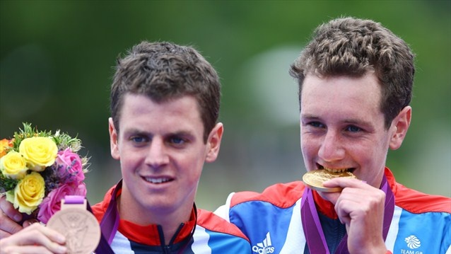Alistair Brownlee (R) of Great Britain poses with his gold medal next to his brother and bronze medalist Jonathan Brownlee of Great Britain during the medal ceremony for the men's Triathlon on Day 11 of the London 2012 Olympic Games at Hyde Park