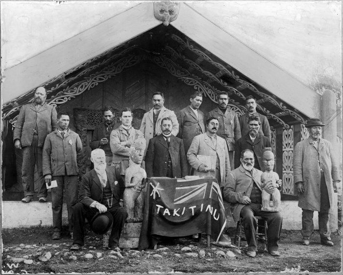 Members of the first meeting of the Takitimu Maori Council,10 June 1902. Seated; Mr Brooking; Otene Pitau. Front row standing; Takina of Kaiti; Charles Ferris of Gisbone; Hetekia Te Kane Pere of Gisborne; Paratene Tatae of Manutuke; Hemi Tutapu; Matenga Taihuka Te Kooti (on far right). Back row; Hapi Hinaki of Whangara; Paora Kohu of Muriwai; Pewhairangi of Tokomaru Bay; Rangi of Tolaga Bay; Arani Kunaiti of Te Reinga. Picture of Te Poho o Rawiri ll before its relocation to Kaiti Hill in…