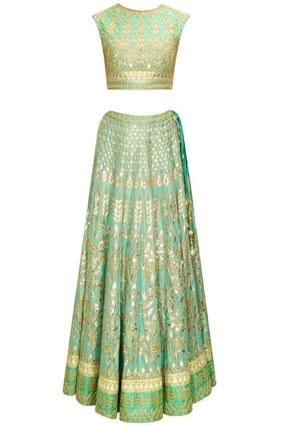 Aqua gota patti embroidered lehenga set by Anita Dongre. Shop now…
