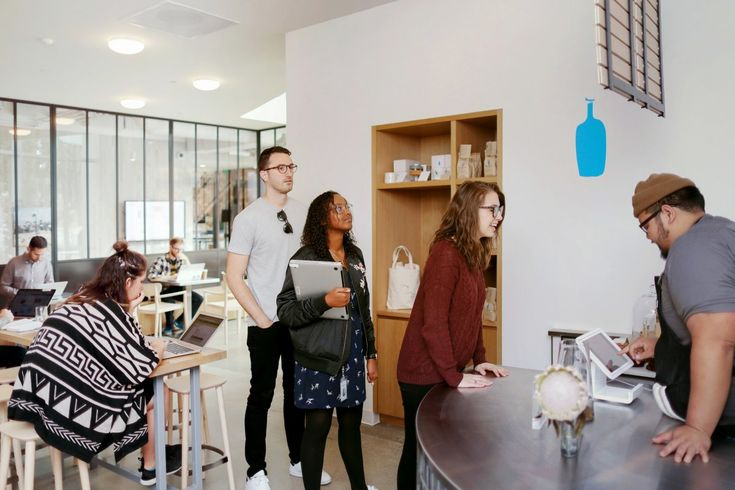 An in-house Blue Bottle coffee shop lets employees buy espresso, lattes, coffee pastries, and waffles.