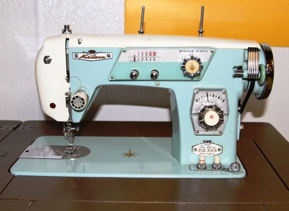 white deluxe zig zag sewing machine