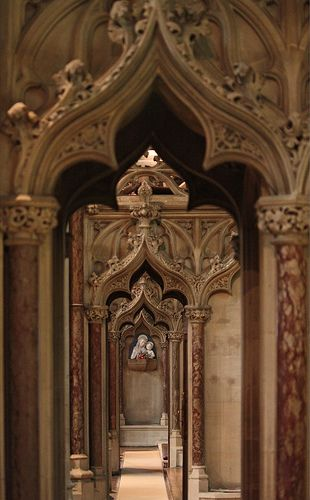Ogee corridor. An ambulatory formed from ogee arches in the Farm Street church in London. The double-curve ogee arch was introduced from the Arab world in the 14th century and became popular throughout medieval England; it is here used in a Gothic revival church.