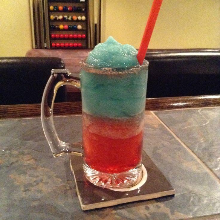 Fire & Ice  1 oz grenadine, 1 oz cherry heering, 1 oz malibu, ice, 1 oz blue curacau, 1 oz amaretto, ice