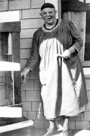 Emily Carr on the porch of her home at 316 Beckley Avenue in James Bay (Vancouver Island, Victoria, British Columbia).
