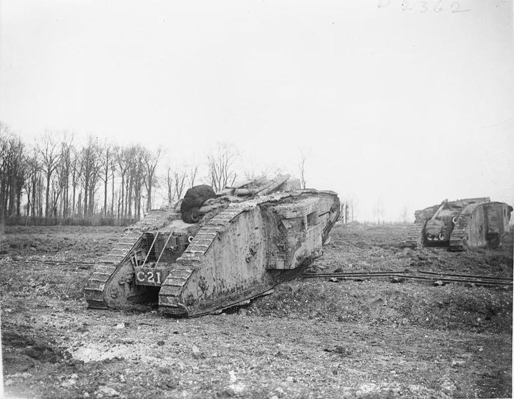 TANK WARFARE DURING FIRST WORLD WAR (Q 6298)   Two 'C' Battalion Mark II Tanks (C21 and C26) go into action during the Battle of Arras. They are fitted with torpedo booms for unditching.
