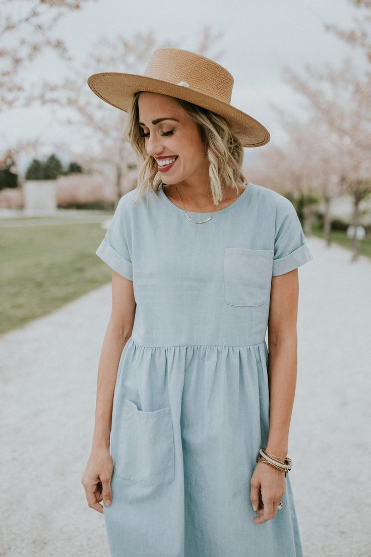 Woven Midi Dress  Light Denim Wash  Rounded Neckline  Cinched Waist  Chest + Skirt Pocket  Cuffed Short Sleeve  Gathered Waist  Over the Knee Length  Fits True to Size