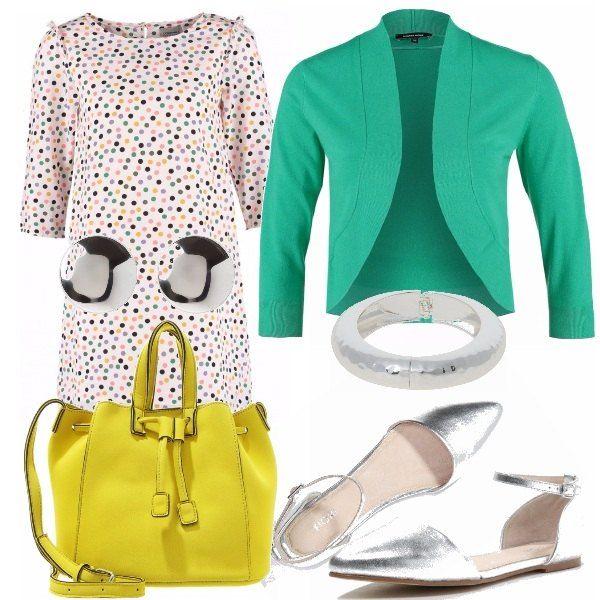 Vestito a pois colorati, abbinato a un cardigan verde acqua, borsa gialla, scarpe argentate che riprendono il bracciale e gli orecchini. Outfit molto colorato che trasmette allegria.