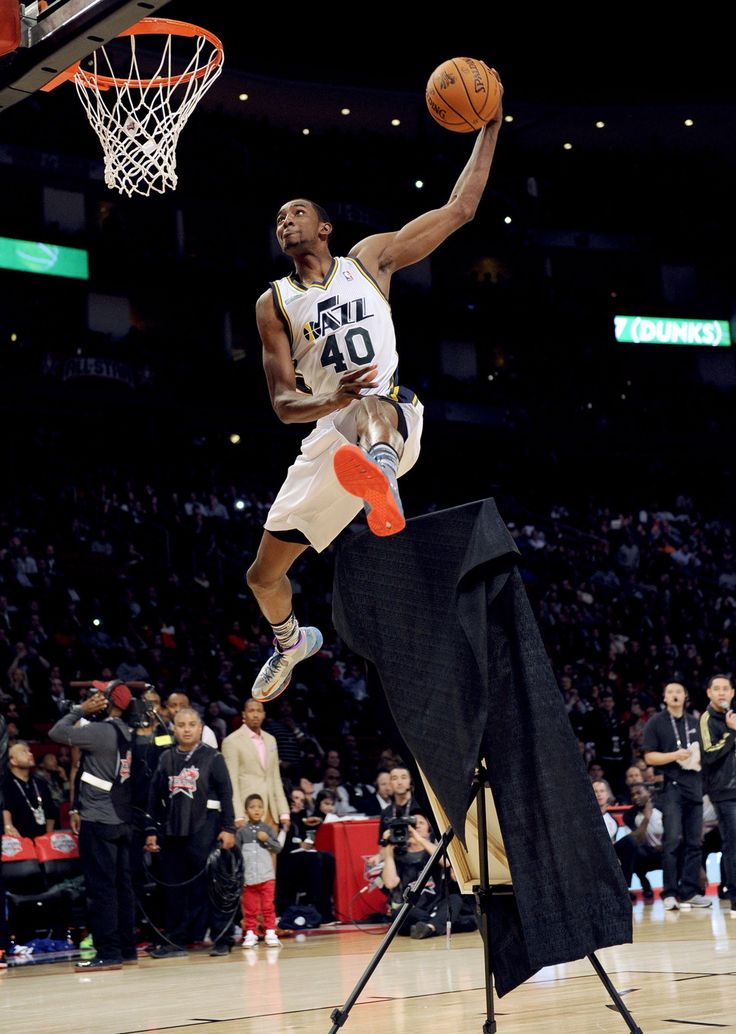 Jeremy Evans of the Utah Jazz leaps over a portrait of himsef at the slam dunk contest during NBA All-Star Saturday Night basketball Saturday, Feb. 16, 2013, in Houston. (AP Photo/Pat Sullivan)