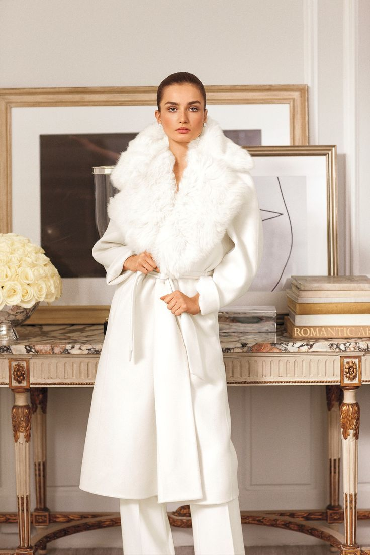 Crafted in Italy, our Ralph Lauren Collection white Leonarda coat is designed with a plush Toscana shearling collar and an elegant wrap silhouette.
