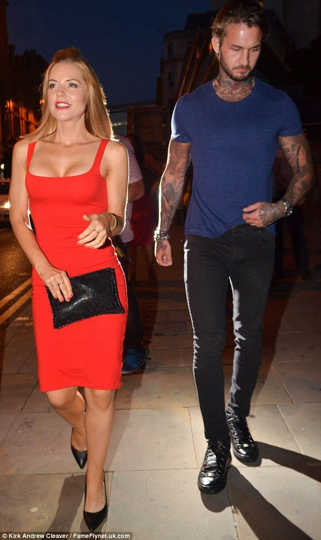The Lady in Red: Stephanie Waring made an elegant entrance in a scarlet midi-dress with her new boyfriend in tow