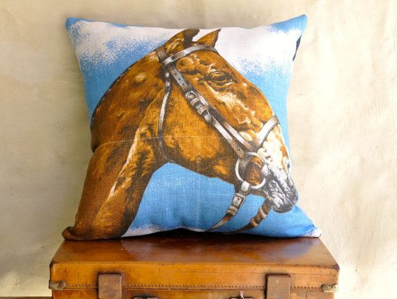 Blue background and brown horse.    Made with a vintage Irish linen tea towel, new unused condition. I have given it one wash to pre-shrink