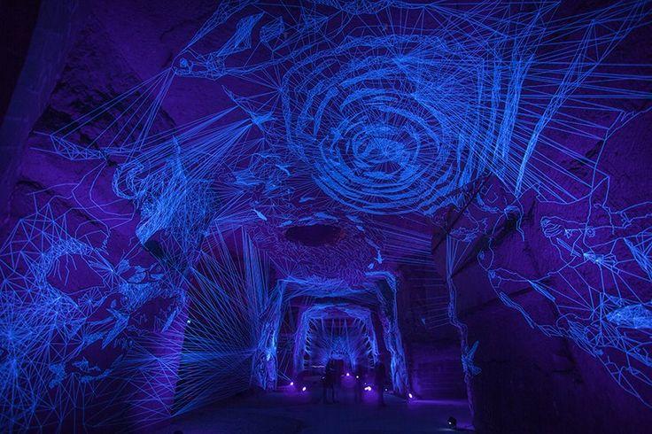 Stellar Caves: Immersive Tunnels of UV-Illuminated Thread Drawings by Julien Salaud