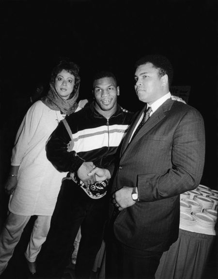 <p> Muhammad Ali and his wife Lonnie congratulate new boxing heavyweight champion Mike Tyson at his coronation ceremony at the Las Vegas Hilton in 1986 (Isaac Sutton/Ebony Collection)</p>