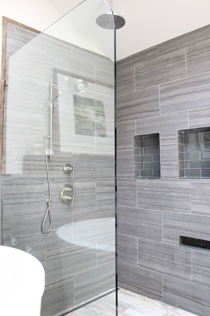 12x24 tiles all the way to the ceiling with minimal grout lines. (Via design indulgence: BEFORE AND AFTER)