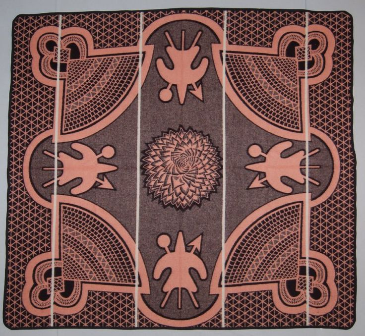 'Kharetsa' Jacquard woven blanket, the design with a Spiral Aloe at centre flanked by the Basotho shield with crossed 'assegai' (spear) and 'knobkerrie' (club) as well as the 'mokorotlo' (woven Basotho hat), in salmon pink and black with four vertical 'pin stripes' in white