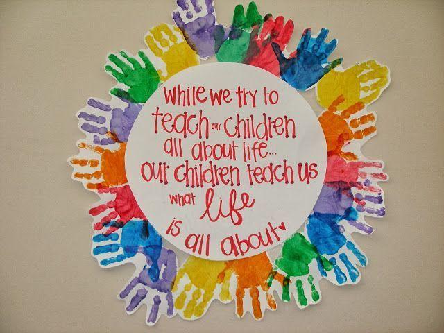 Children's Hand Print Wreath w/ quote in center.
