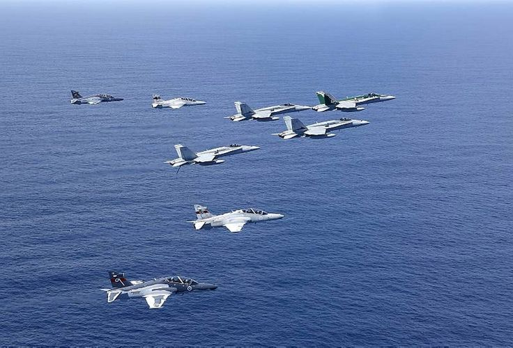 RAAF Hawk-127 aircraft from 76 Squadron and F/A-18 Hornets from 77 Squadron fly in formation toward Sydney harbour to conduct a flypast for the IFR.