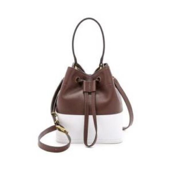 """Fri-yay Sale Tory Burch Bucket Bag White and barrel cored leather bucket bag with one handle. Removable and adjustable 15"""" shoulder strap. Drawstring closure. In excellent used condition. Comes with dust bag. Tory Burch Bags Shoulder Bags"""