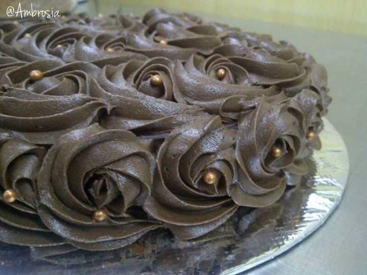 Swirls of rich chocolate loaded on a fluffy moist cake that tastes just as divine as it looks.  #Rose #Chocolate #Cakes #FoodLove #Ambrosia