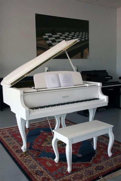 White baby grand piano ❤ I just love these!! http://pinterest.com/cameronpiano
