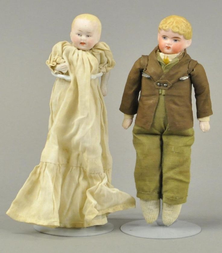 TWO BISQUE DOLL HOUSE FIGURES